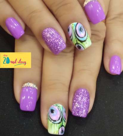 Peacock nail design created by the 20 nail story