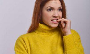 women biting their nails