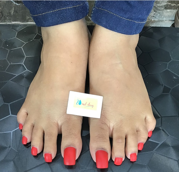 Feet nail design in red colour