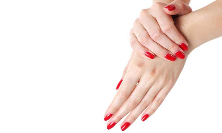 hand with red nail paint